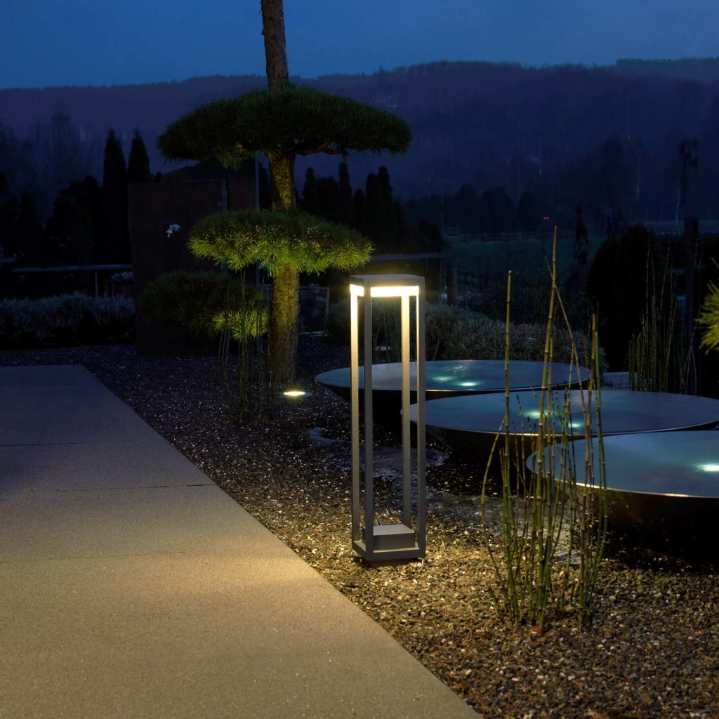 A beautifully designed path light sets the scene for a modern garden.